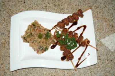 Reispfanne mit Putenspießen - Rezept