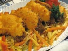 Überbackene Schweinskoteletts auf Gemüse - Rezept