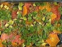 Lachs in der Folie gegart mit Avocado, Orangen und grünen Oliven - Rezept