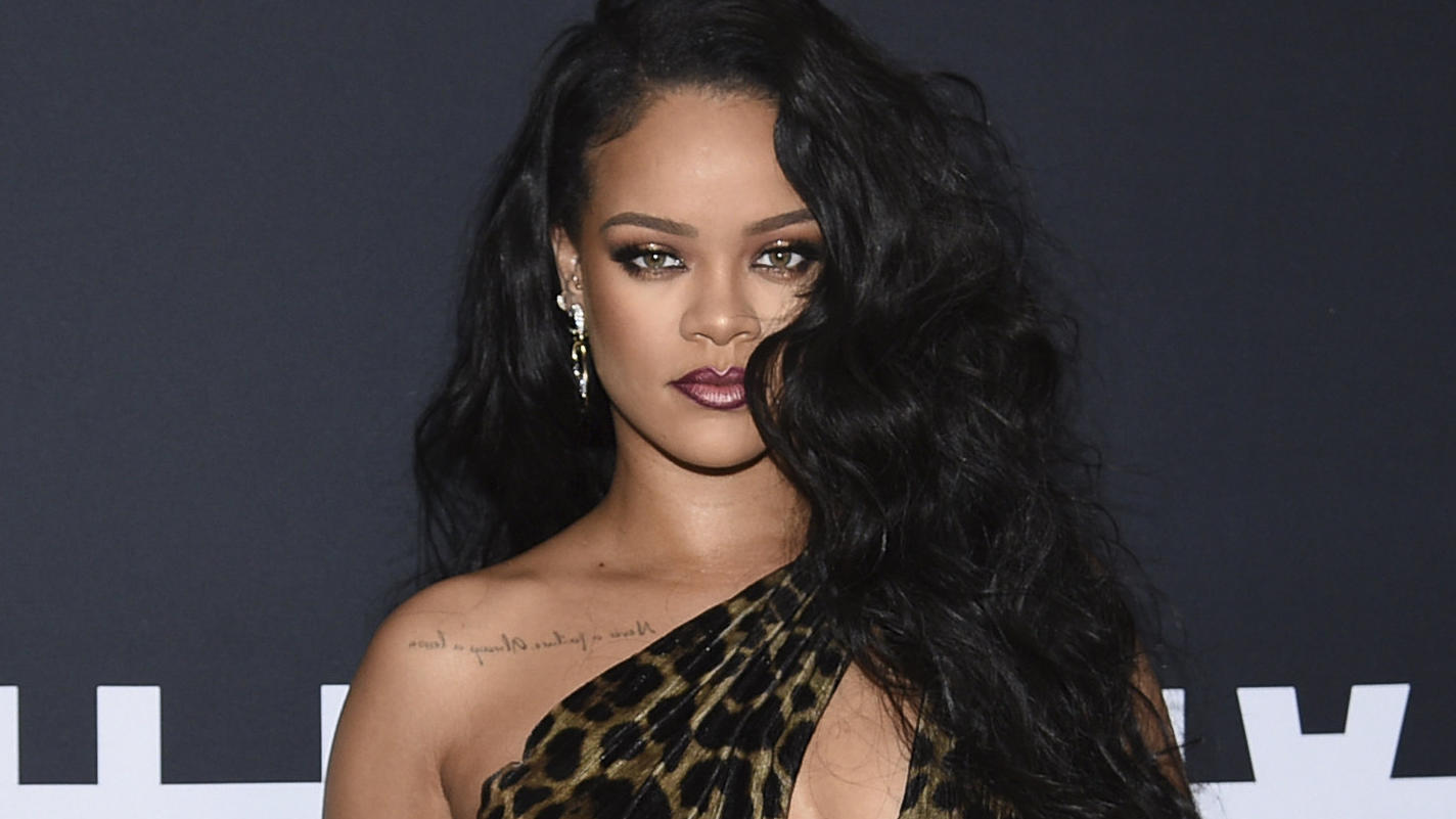 """FILE - Singer and fashion designer Rihanna attends the """"Rihanna"""" book launch event in New York on Oct. 11, 2019. Dozens of artists have objected to President Donald Trump using their music in his presidential campaigns. Rihanna demanded that Trump st"""