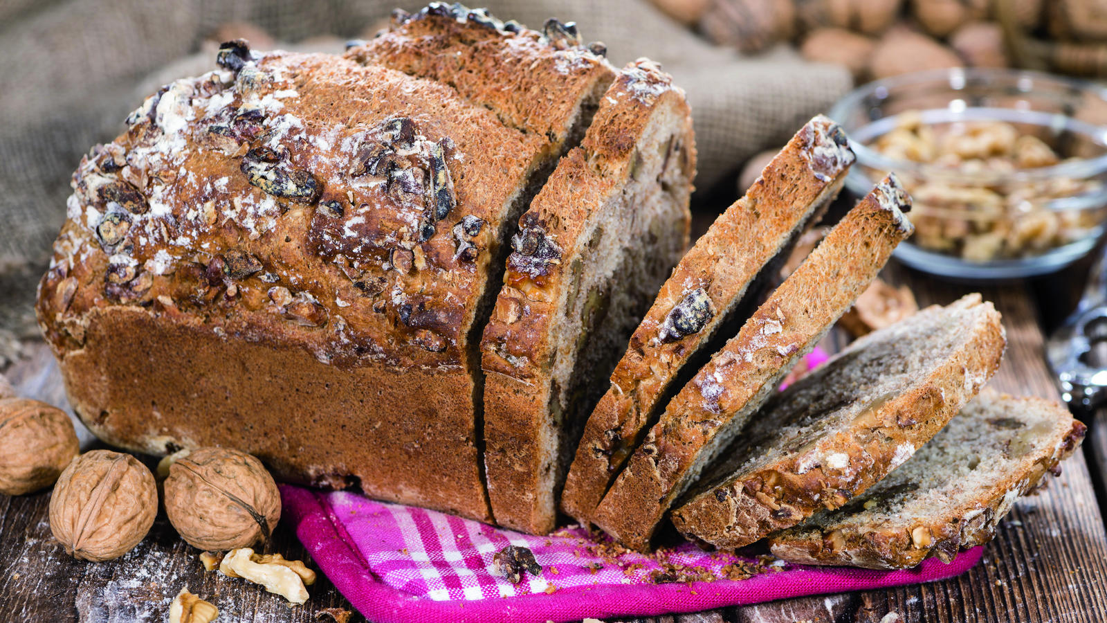 Fresh made Walnut Bread (detailed close-up shot) on wooden background